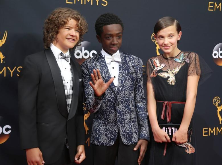 Actors Gaten Matarazzo (L), Caleb McLaughlin and Millie Bobby Brown from the Netflix series ''Stranger Things'' arrive at the 68th Primetime Emmy Awards in Los Angeles, California U.S., September 18, 2016.  REUTERS/Lucy Nicholson