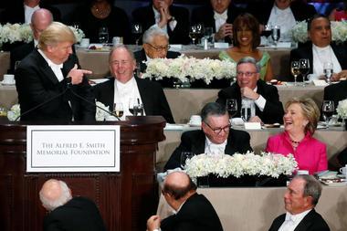 Democratic U.S. presidential nominee Clinton reacts to a joke by Republican...