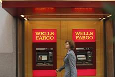 Wells Fargo bank teller machines are seen in San Francisco, California, U.S. October 10, 2013.   REUTERS/Robert Galbraith /File Photo