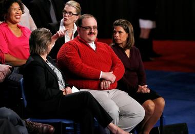 Ken Bone waits to ask a question about energy policy and jobs to Republican...