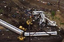 Emergency workers look through the remains of a derailed Amtrak train in Philadelphia, Pennsylvania May 13, 2015. REUTERS/Lucas Jackson