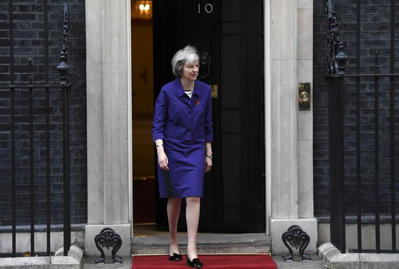Britain's Prime Minister Theresa May walks out of 10 Downing Street to welcome Colombia's President Juan Manuel Santos in London, Britain November 2, 2016. REUTERS/Toby Melville