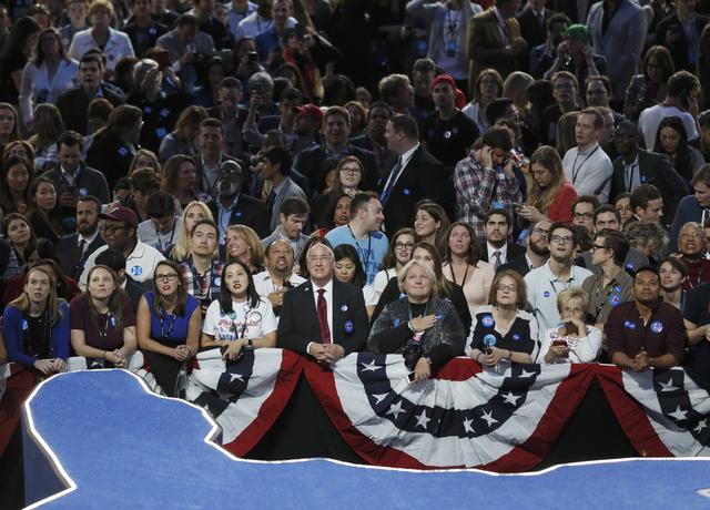 Supporters of Democratic presidential candidate Hillary Clinton watch returns on a large screen at her election night rally at the Jacob K. Javits Convention Center in Manhattan, New York, U.S., November 8, 2016. REUTERS/Rick Wilking