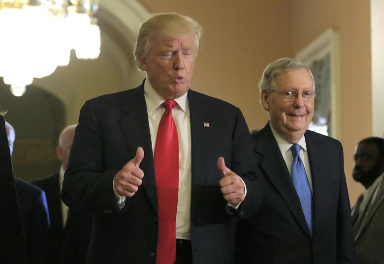 U.S. President-elect Donald Trump (L) gives a thumbs up sign as he walks with Senate Majority Leader Mitch McConnell (R-KY) on Capitol Hill in Washington, U.S., November 10, 2016. REUTERS/Joshua Roberts