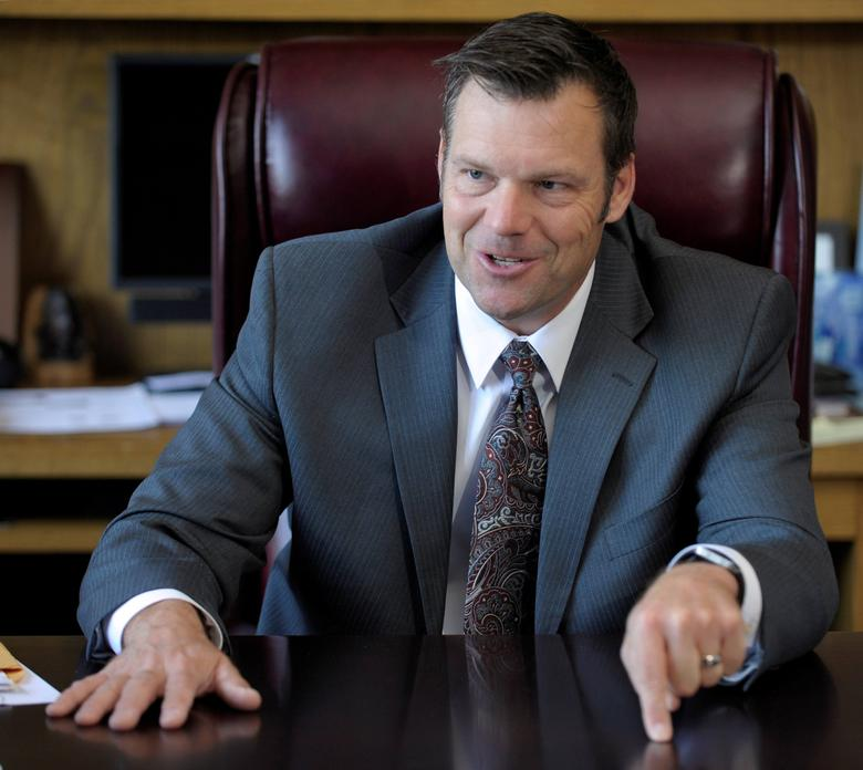Kansas Secretary of State Kris Kobach talks in his Topeka, Kansas, U.S., office May 12, 2016. REUTERS/Dave Kaup/File Photo