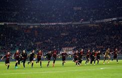 AC Milan v Juventus - San Siro  stadium, Milan  Italy- 22/10/16  - AC Milan's players celebrate after winning the match.  REUTERS/Alessandro Garofalo
