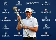 Golf - DP World Tour championship- Dubai, UAE - 20/11/16 - Matthew Fitzpatrick of England holds the champions trophy after winning DP World Tour championship.  REUTERS/Ahmed Jadallah