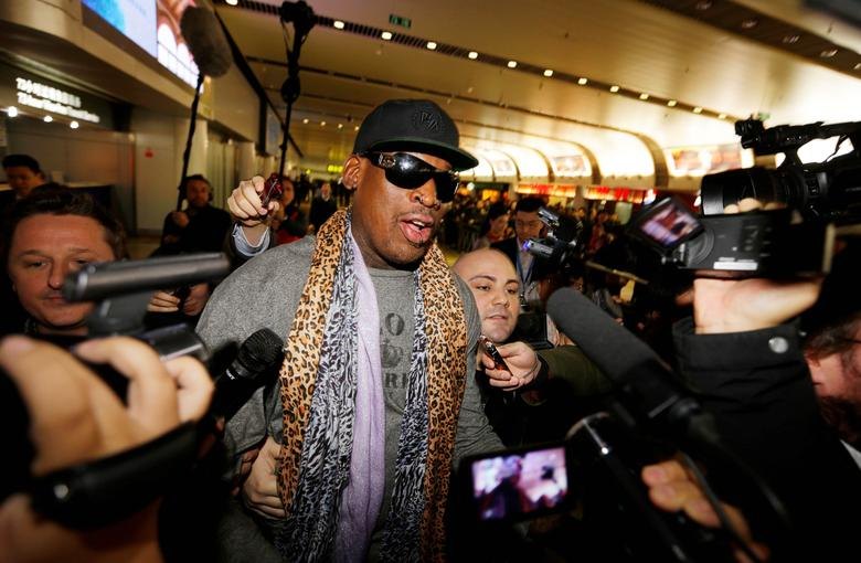 FILE PHOTO - Former NBA basketball player Dennis Rodman speaks to the media after returning from his trip to North Korea at Beijing airport, December 23, 2013. REUTERS/Jason Lee/File Photo