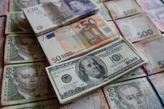U.S. 100 dollar, 50 euro, 20 pound and Ukrainian 500 hryvnia banknotes are seen in this picture illustration taken in Kiev, Ukraine, October 31, 2016. REUTERS/Valentyn Ogirenko/Illustration