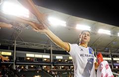 September 27, 2015; Carson, CA, USA; Los Angeles Galaxy midfielder Steven Gerrard (8) greets fans following the 3-2 victory against FC Dallas at StubHub Center. Mandatory Credit: Gary A. Vasquez-USA TODAY Sports