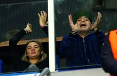 Croatia v Argentina - Davis Cup Final - Arena Zagreb, Croatia - 25/11/16 Diego Armando Maradona and his girlfrend Rocio Oliva react during the Croatia's Marin Cilic match against Argentina's Federico Delbonis. REUTERS/Antonio Bronic
