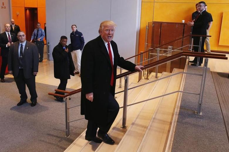 U.S. President elect Donald Trump walks up a staircase to depart the lobby of the New York Times building after a meeting in New York, U.S., November 22, 2016.  REUTERS/Lucas Jackson