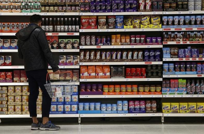 A shopper browses items at a Sainsbury's store in London, Britain, October 11, 2016.    REUTERS/Neil Hall/File Photo