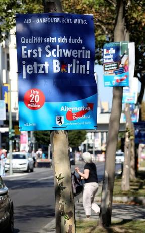 Election posters of the anti-immigration party Alternative for Germany (AfD) for the upcoming local city elections are pictured in Berlin, Germany, September 15, 2016. The slogan reads ''Ensuring excellence. First Schwerin now Berlin!''.     REUTERS/Fabrizio Bensch