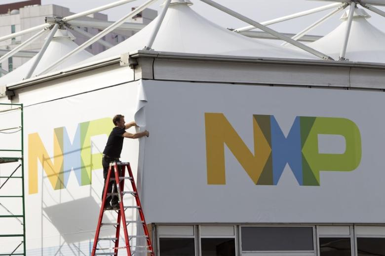 A man works on a tent for NXP Semiconductors in preparation for the 2015 International Consumer Electronics Show (CES) at Las Vegas Convention Center in Las Vegas, Nevada, U.S. on January 4, 2015.   REUTERS/Steve Marcus