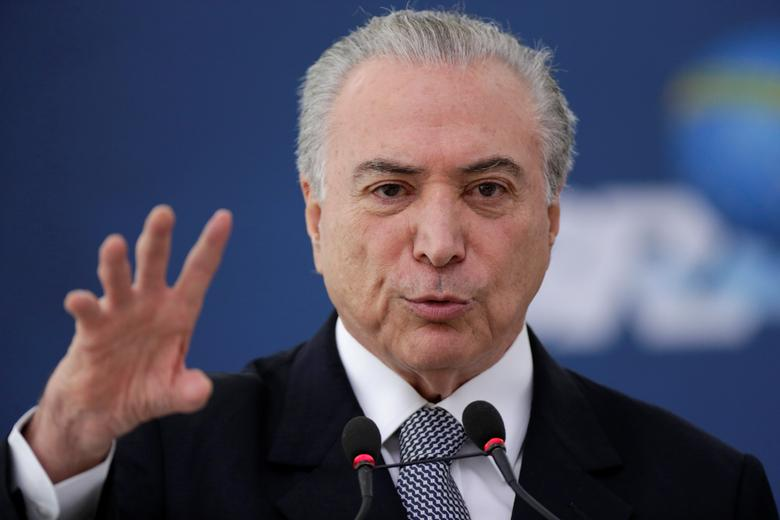 Brazil's President Michel Temer gestures during the launch of the new financing line of Bank Caixa Economica Federal at the Planalto Palace in Brasilia, Brazil, November 24, 2016. REUTERS/Ueslei Marcelino