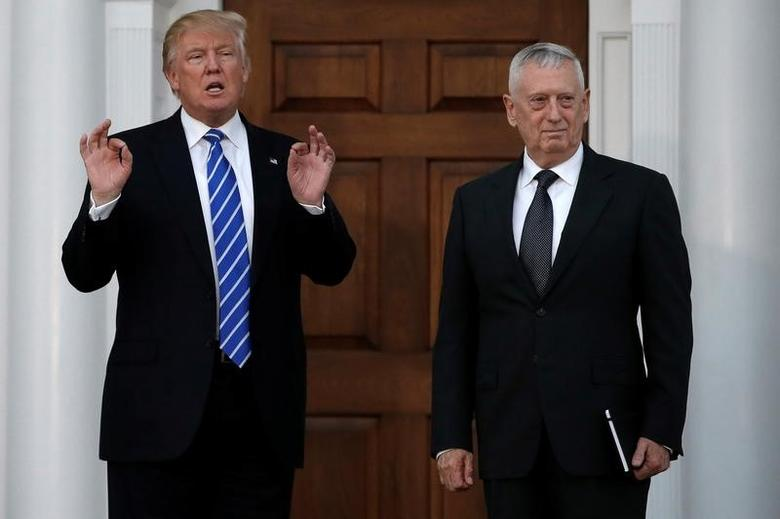 U.S. President-elect Donald Trump stands with retired Marine Gen. James Mattis following their meeting at the main clubhouse at Trump National Golf Club in Bedminster, New Jersey, U.S., November 19, 2016.  REUTERS/Mike Segar - RTSSFLU