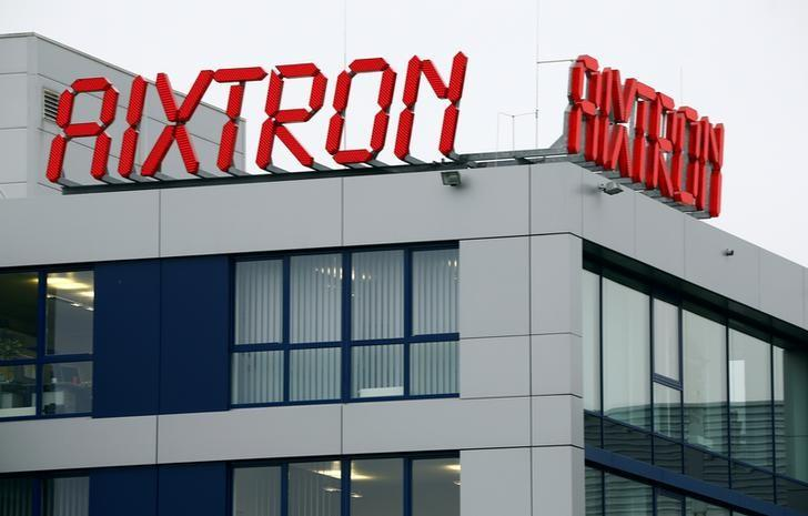 The logo of Aixtron SE is pictured on the roof of the German chip equipment maker's headquarters in Herzogenrath near the western German city of Aachen, October 25, 2016. Fujian Grand Chip Investment Fund LP (FGC), a Chinese company bidding to buy Aixtron in a 670 million euro ($728 million) deal, said on Tuesday it may push ahead with its takeover plans even though the Germany government unexpectedly withdraws approval of the deal.  REUTERS/Wolfgang Rattay - RTX2QE37