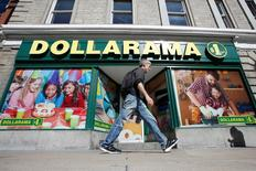 A pedestrian walks past a Dollarama store in Ottawa, Ontario, Canada, September 1, 2016. REUTERS/Chris Wattie - RTX2NT0F