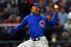 Nov 2, 2016; Cleveland, OH, USA; Chicago Cubs relief pitcher Aroldis Chapman throws a pitch against the Cleveland Indians in the 8th inning in game seven of the 2016 World Series at Progressive Field. Mandatory Credit: Tommy Gilligan-USA TODAY Sports