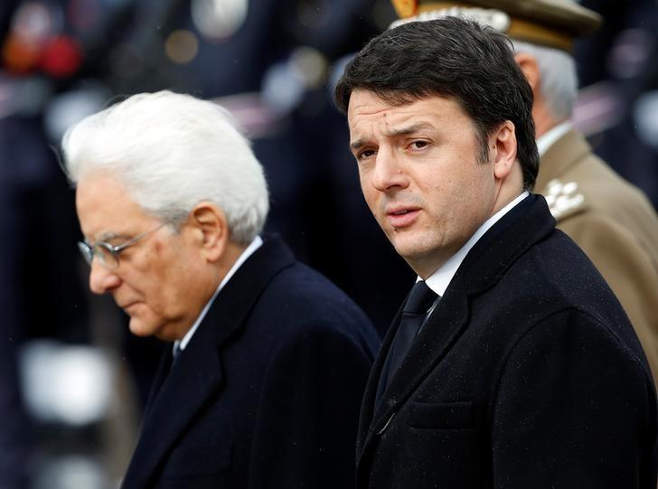 File picture shows Italian Prime Minister Matteo Renzi (R) and Italy's President Sergio Mattarella as they arrive at the Unknown Soldier's monument in central Rome, February 3, 2015. REUTERS/Remo Casilli/Files