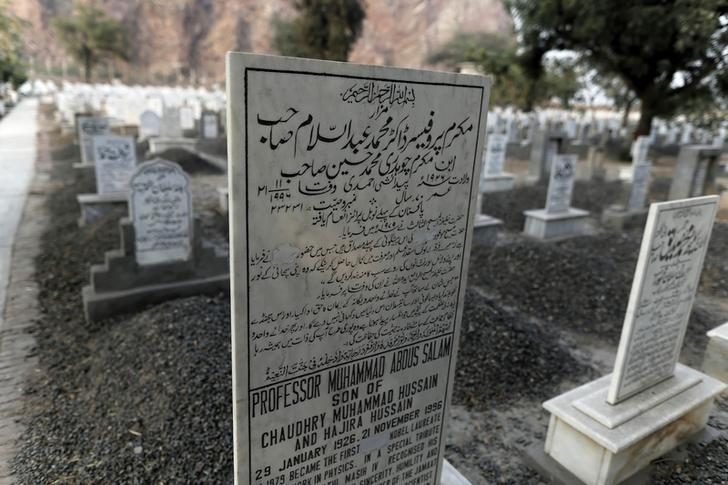 The word ''Muslim'' has been painted over by vigilantes, on the tombstone of Pakistani scientist Abdus Salam, a member of the Ahmadi community and Pakistan's only Nobel laureate, in the Ahmadi graveyard in the town of Rabwa December 9, 2013.  Picture taken December 9, 2013. REUTERS/Zohra Bensemra (PAKISTAN - Tags: RELIGION CRIME LAW CIVIL UNREST SCIENCE TECHNOLOGY)