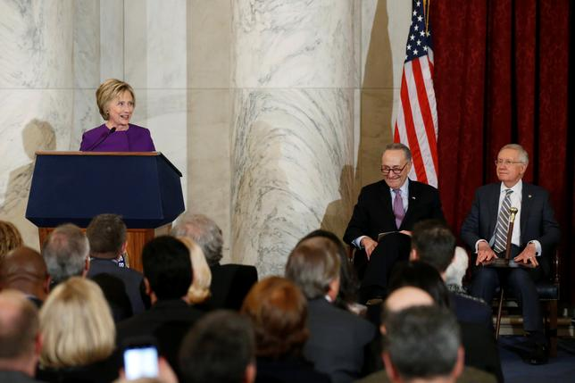 Former Secretary of State Hillary Clinton (L-R) and U.S. Senator Chuck Schumer (D-NY) participate in a ceremony to unveil a portrait honoring retiring Senate Minority Leader Harry Reid (D-NV) on Capitol Hill in Washington, U.S. December 8, 2016. REUTERS/Jonathan Ernst