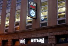 The logos of German car manufacturers Volkswagen and Audi and Swiss car importer AMAG are seen at an office building in Zurich, Switzerland September 28, 2016.  REUTERS/Arnd Wiegmann