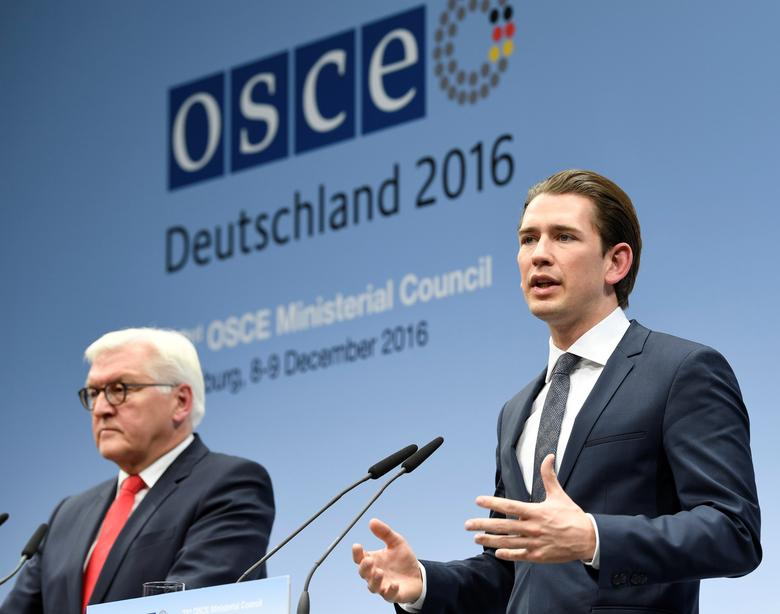 Austrian Foreign Minister Sebastian Kurz (R) and his German counterpart  Frank-Walter Steinmeier address media at the 23rd OSCE Ministerial Council organized by Germany's OSCE Chairmanship in Hamburg, Germany December 9, 2016. REUTERS/Fabian Bimmer