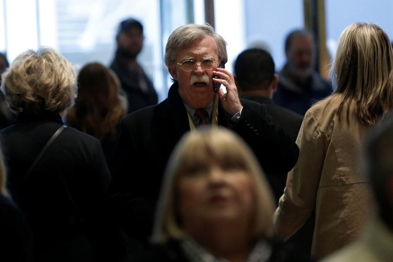 Former U.S. Ambassador to the United Nations John Bolton speaks on a mobile phone as he arrives for a meeting with U.S. President-elect Donald Trump at Trump Tower in New York, U.S., December 2, 2016.   REUTERS/Mike Segar