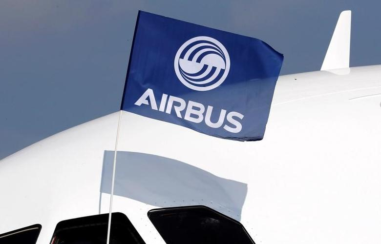 A flight test engineer holds an Airbus Group flag after the first flight of the Airbus A320neo (New Engine Option) in Colomiers near Toulouse, France, September 25, 2014. REUTERS/Regis Duvignau/File Photo