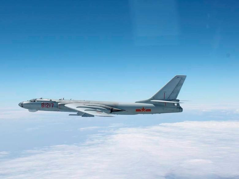 A Chinese military plane H-6 bomber flies through airspace between Okinawa prefecture's main island and the smaller ''Miyako island' in southern Japan, out over the Pacific, in this handout photo taken October 27, 2013 by Japan Air Self-Defence Force and released by the...