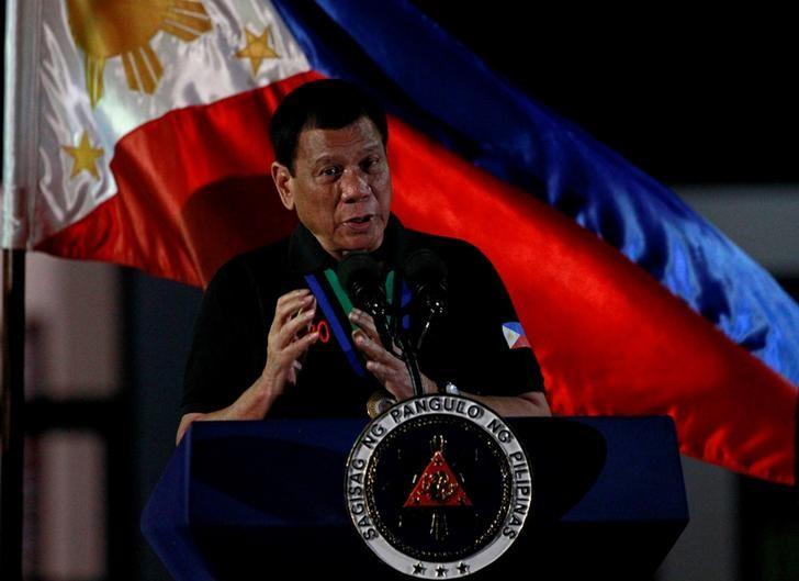 Philippine President Rodrigo Duterte speaks during a visit at Camp Servillano S. Aquino in San Miguel, Tarlac, Philippines December 11, 2016. REUTERS/ Czar Dancel