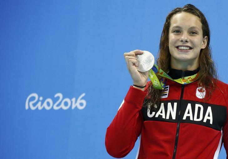 Penelope Oleksiak (CAN) of Canada poses with her medal after Women's 100m Butterfly Victory Ceremony, Olympic Aquatics Stadium, Rio de Janeiro, Brazil, August 7, 2016.