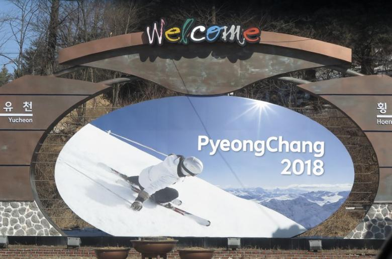 The advertising hoarding promoting the 2018 Winter Olympics stands in the mountain cluster of PyeongChang February 9, 2015.  REUTERS/Pawel Kopczynski