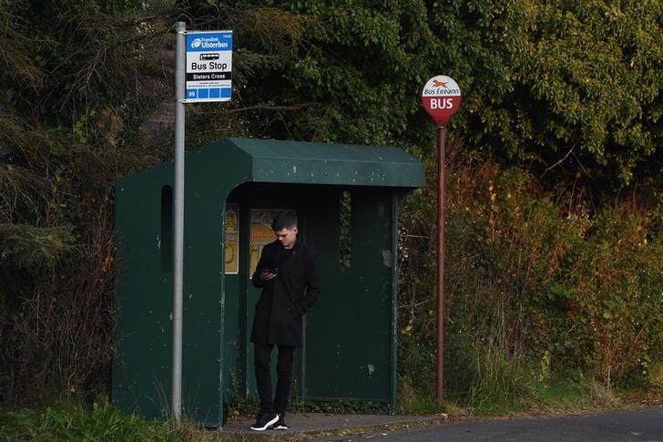 A bus stop with both Northern Irish and Irish stop signs are seen in the border town of Belleek, Northern Ireland October 14, 2016. REUTERS/Clodagh Kilcoyne