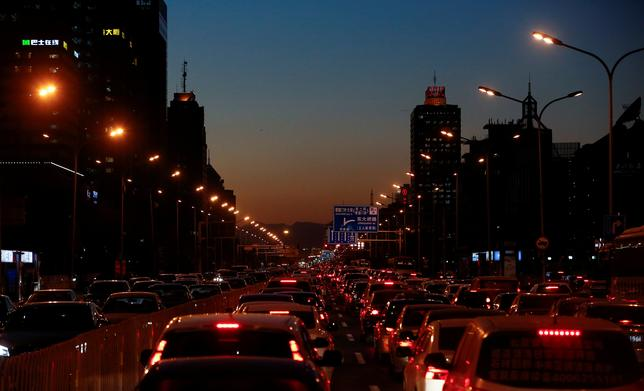 Cars stand bumper to bumper in the evening rush hour traffic jam in central Beijing, China, December 8, 2016.   REUTERS/Thomas Peter/File Photo
