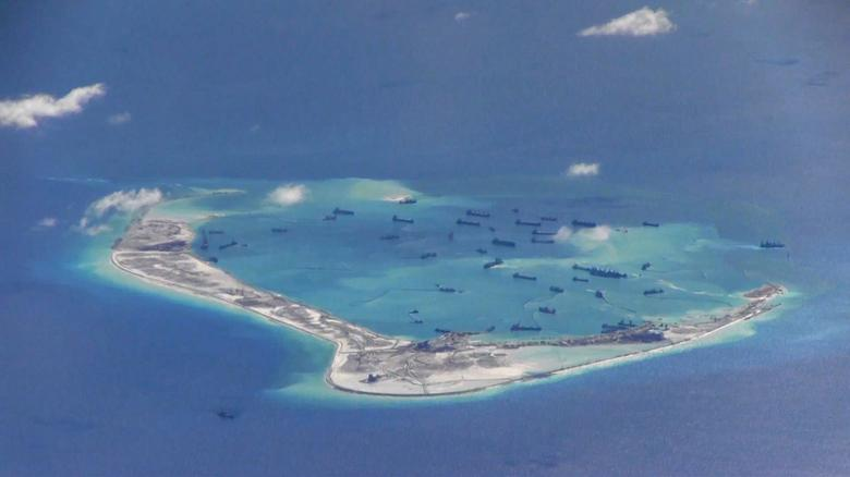 Chinese dredging vessels are purportedly seen in the waters around Mischief Reef in the disputed Spratly Islands in the South China Sea. U.S. Navy/Handout
