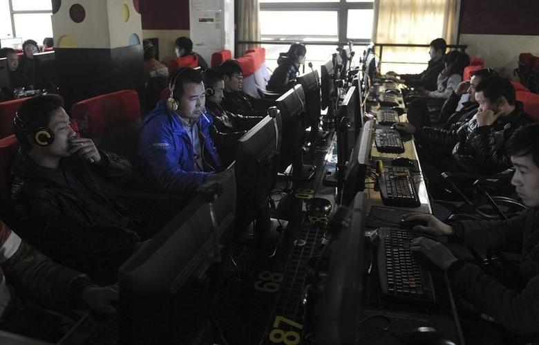 FILE PHOTO - Customers use computers at an internet cafe in Hefei, Anhui province March 16, 2012. REUTERS/Stringer