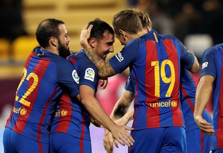 Football Soccer - Barcelona v Saudi Arabia's Al-Ahli - International Friendly Match - Doha, Qatar - 13/12/16 Barcelona's players celebrate their goal. REUTERS/Ibraheem Al Omari/Files