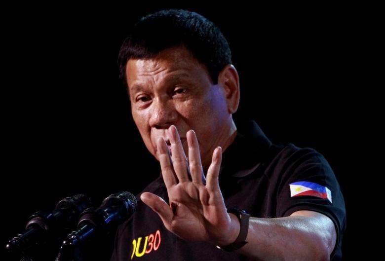 Philippine President Rodrigo Duterte speaks during a visit in Tarlac city in northern Philippines December 11, 2016. REUTERS/Czar Dancel