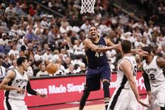 Dec 18, 2016; San Antonio, TX, USA; San Antonio Spurs center Pau Gasol (16) and forward LaMarcus Aldridge (12) knock the ball away from New Orleans Pelicans center Alexis Ajinca (42) during the second half at AT&T Center. Mandatory Credit: Soobum Im-USA TODAY Sports