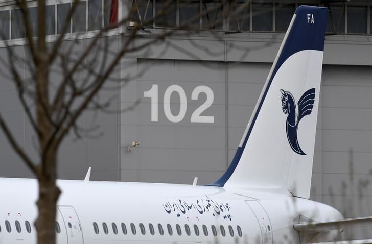 An Airbus A321 with the description ''The Airline of the Islamic Republic of Iran'' below the tail fin is parked at the Airbus facility in Hamburg Finkenwerder, Germany, December 19, 2016.       REUTERS/Fabian Bimmer