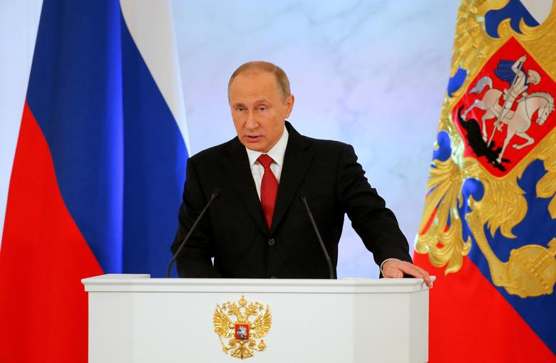 Russian President Vladimir Putin delivers a speech during his annual state of the nation address at the Kremlin in Moscow, Russia, December 1, 2016. REUTERS/Maxim Shemetov/File Photo