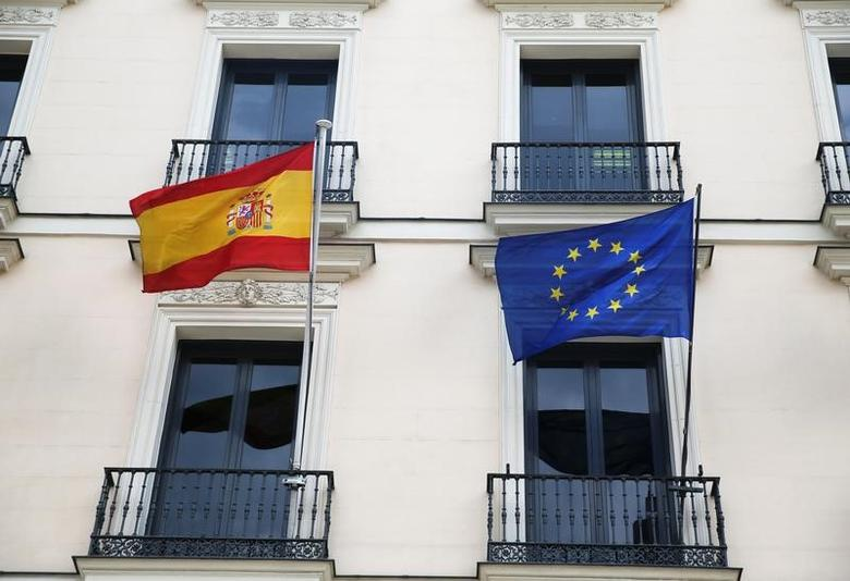 The European Union flag and the Spanish flag are seen on the Department of Education building in Madrid, Spain, May 18, 2016. REUTERS/Juan Medina