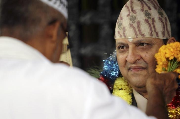 Nepal's former King Gyanendra (R) listens to a well-wisher during his 65th birthday celebrations in Kathmandu July 7, 2011. REUTERS/Navesh Chitrakar/Files