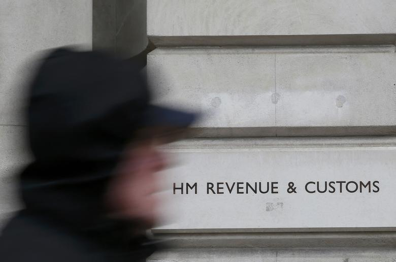 A pedestrian walks past the headquarters of Her Majesty's Revenue and Customs (HMRC) in central London, Britain February 13, 2015.  REUTERS/Stefan Wermuth/File Photo