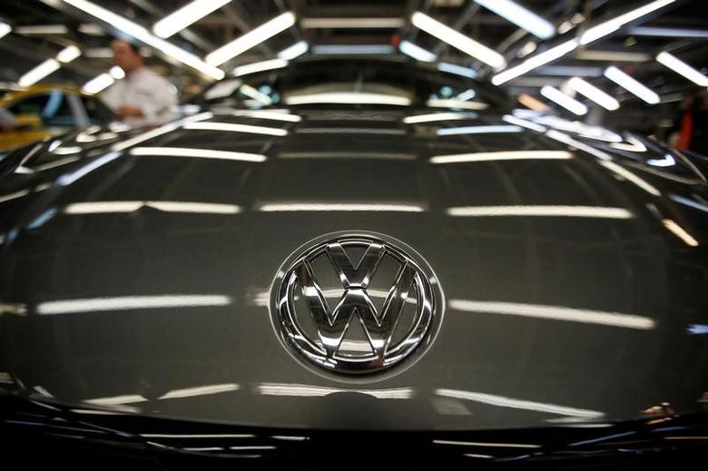 The logo of Volkswagen company is seen on a car on an assembly line at the Volkswagen car factory in Palmela, Portugal, December 9, 2016.   REUTERS/Rafael Marchante