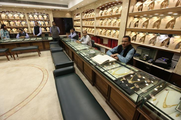 Sales persons wait for customers at a gold jewelry showroom in Chandigarh, India, November 9, 2016. REUTERS/Ajay Verma/Files
