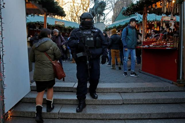 A member of the New York Police Department's Counterterrorism Bureau patrols the Union Square Holiday market following the Berlin Christmas market attacks in Manhattan, New York City, U.S., December 20, 2016. REUTERS/Andrew Kelly
